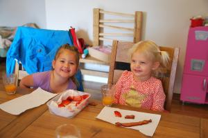 Selah's playdate - helps pass the time with a newborn!  And her first bacon experience!