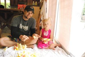 Daddy and Selah string leis