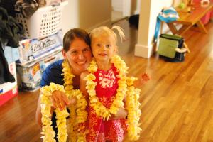 "Mommy & Selah get ready to ""deliver"" leis to neighbors to spread the scent!  ;)"