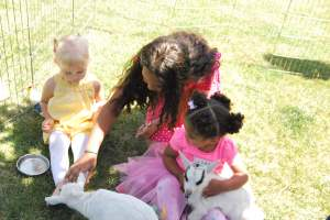 Selah, Eva, and Maia with the goats