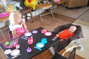 While Selah waits for guests, she has a tea party with her brother.  Very sweet.