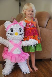 "Selah with her special ""Nica"" piñata - brought all the way to SB on the plane with Auntie Brookie!"