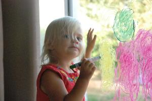 Drawing an Angel on the Window